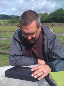 Dom reading iPad