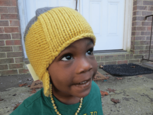 Seriously, look at this face. Let's ignore that he's wearing a t-shirt and my cluttered porch is in the background. How could people not flock to buy this hat that they can only see a portion of amirite?!?
